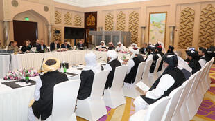 Undated handout picture of U.S., Taliban and Qatar officials during a meeting for peace talks in Doha, Qatar.