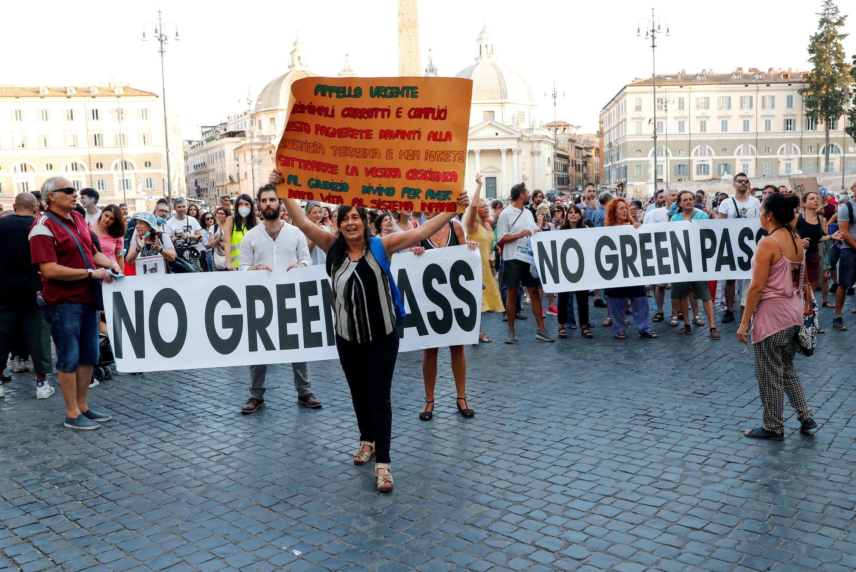 2021-08-14T181750Z_1892667023_RC255P9L0HMT_RTRMADP_3_HEALTH-CORONAVIRUS-ITALY-PROTEST