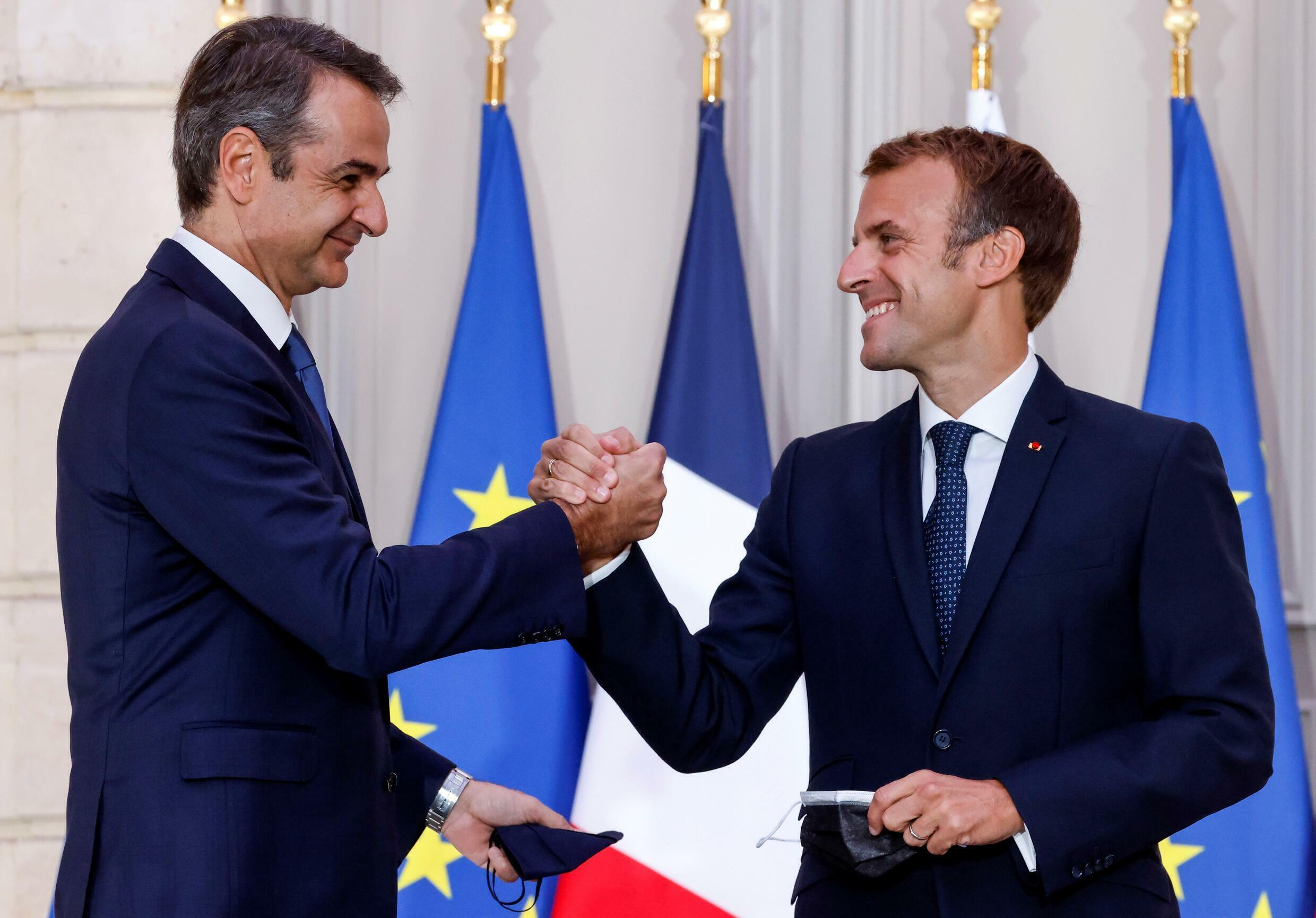 Macron (R) signed the ship deal with Greek Prime Minister Kyriakos Mitsotakis at the Elysee Palace in Paris
