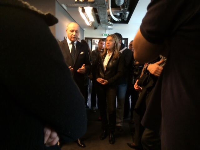 French Foreign Minister Laurent Fabius reacts with RFI chief Marie-Christine Saragosse