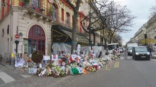 Tributes outside the Bataclan concert hall in Paris, 8 December 2015.