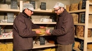 Emmanuel Carbonne (L) and Christophe Lesoin (R) handle a lot of cheese in their maturing cellar