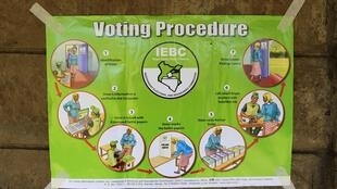 A poster detailing the voting procedure is taped to a wall at Mahiga Primary in Nairobi
