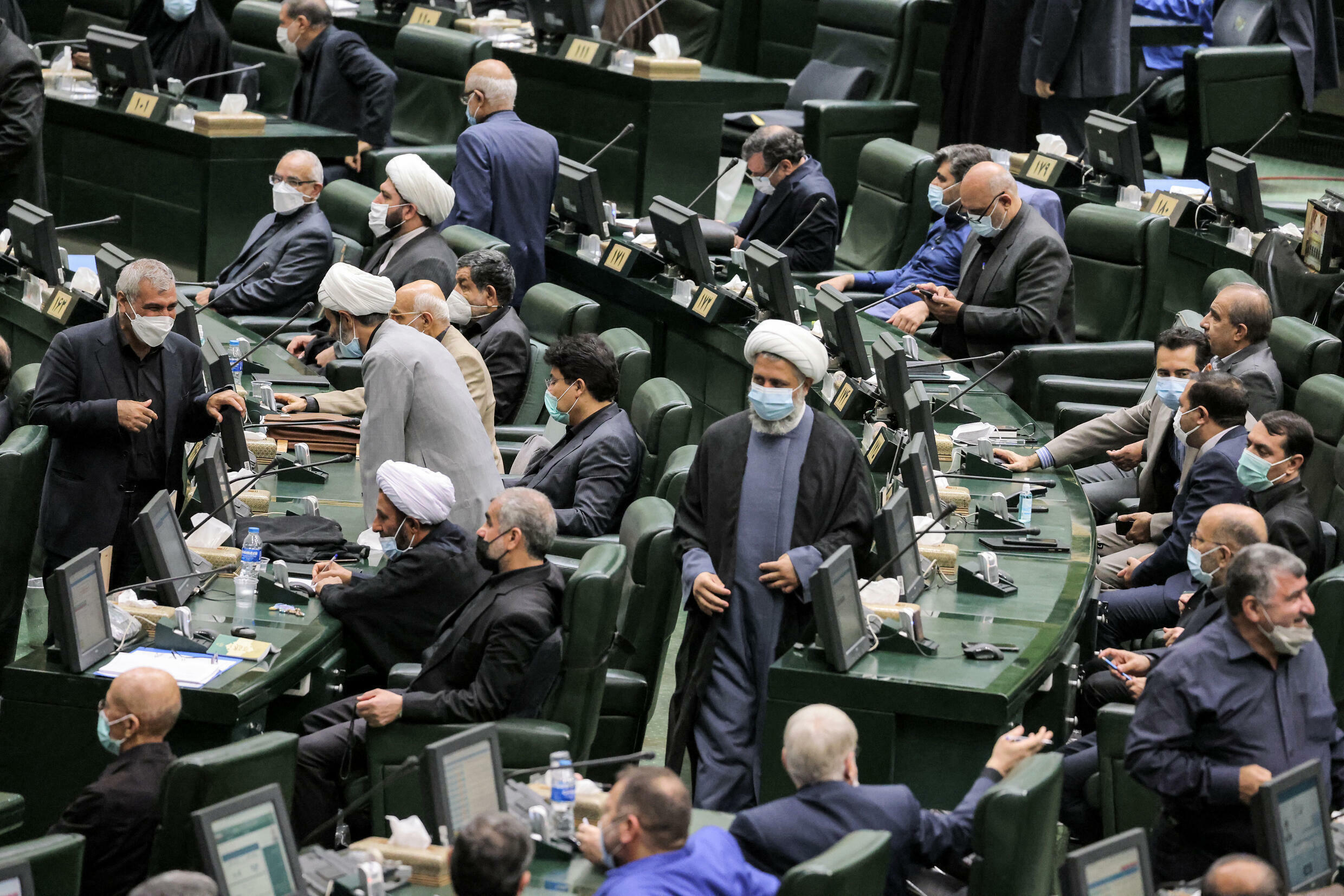 Iranian lawmakers attend a parliamentary session to review the new president's cabinet choices in the capital Tehran on Saturday