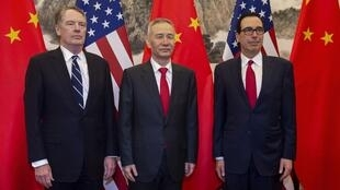 In this file photo taken on March 28, 2019 China's Vice Premier Liu He (C) poses for a photo with US Treasury Secretary Steven Mnuchin (R) and US Trade Representative Robert Lighthizer (L) at Diaoyutai State Guesthouse in Beijing.