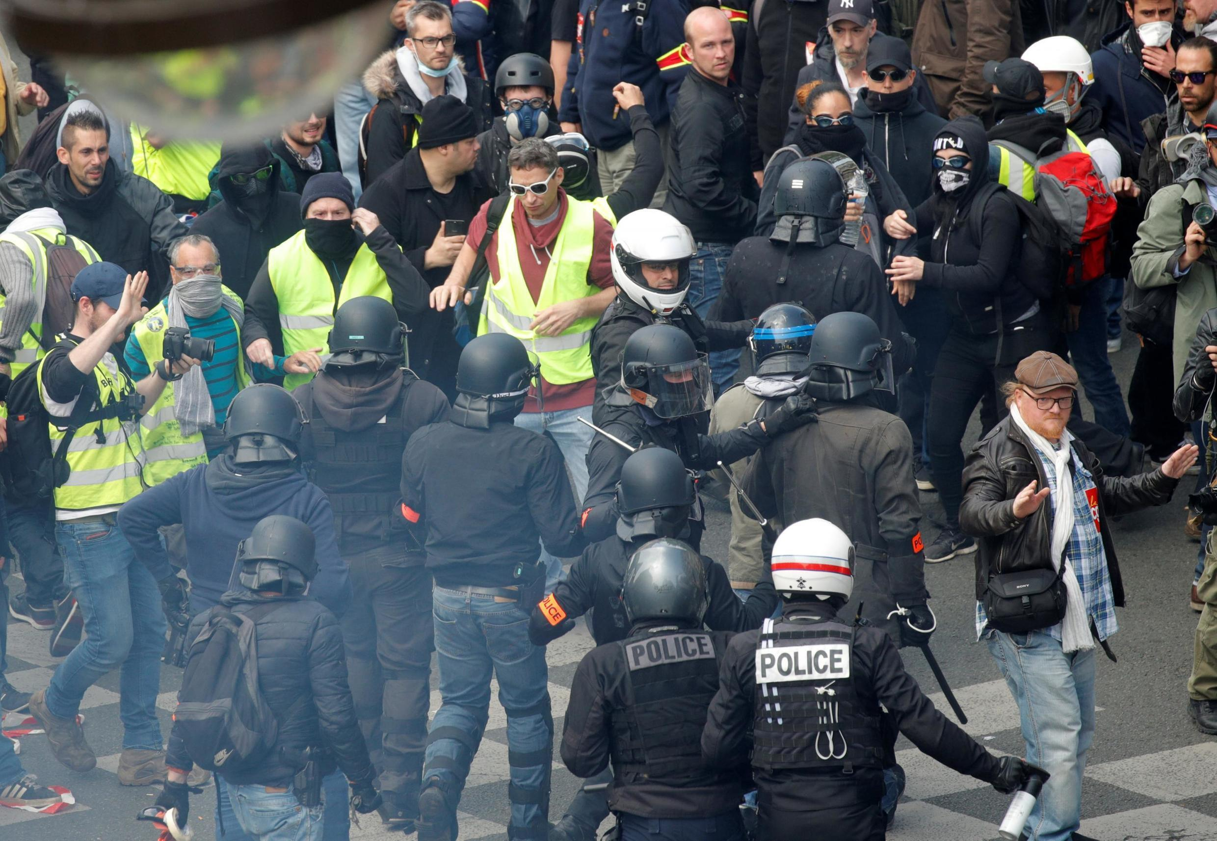 French police apprehend protesters during the traditional May Day labour union march with French unions and yellow vests protesters in Paris, France, May 1, 2019.