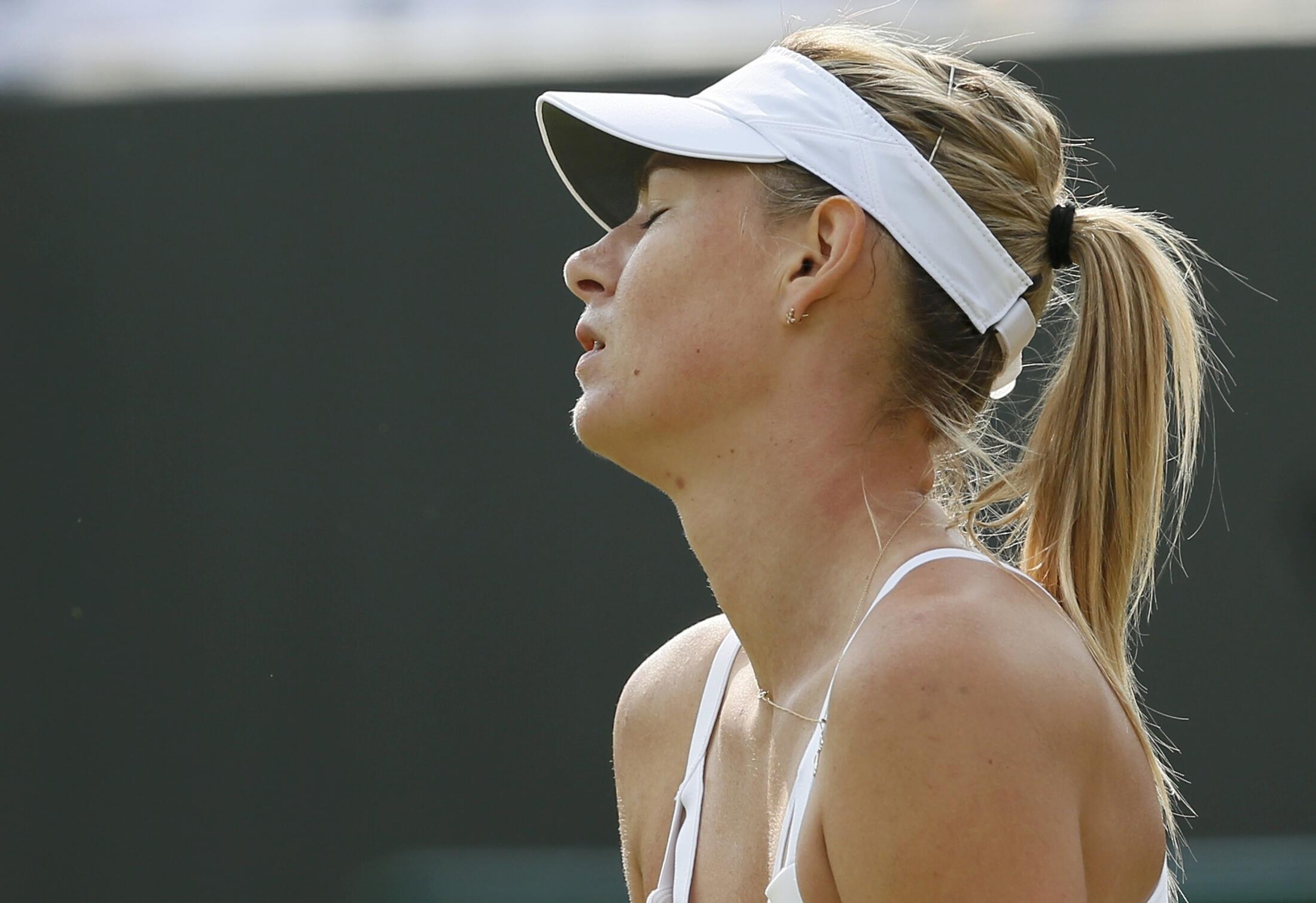 Maria Sharapova a lokacin da ta sha kashi a gasar Wimbledon