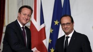 El premier británico David Cameron y el presidente francés François Hollande en París, este 28 de mayo de 2015.