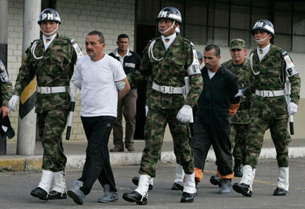 Gerardo Aguilar (2nd from left) escorted by the military, after the rescue operation in 2008