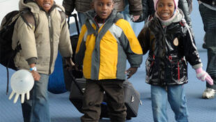 Newly-adopted children, some of the 113 orphans from Haiti who arrived in France, at Paris's Charles de Gaulle airport