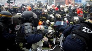 French firefighters face off with French riot police as they demonstrate to protest against working conditions, in Paris, France, January 28, 2020.