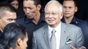 Malaysia trấn áp các tiếng nói đối lập, kể cả những người đòi Thủ tướng Razak trả lời về những cáo buộc tham nhũng - REUTERS /Olivia Harris