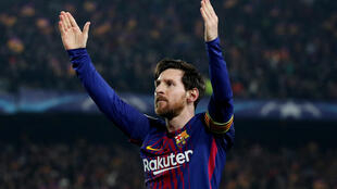 Lionel Messi steered Barcelona into the Champions League quarter-finals with a virtuoso display at the Camp Nou.