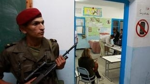 A Tunisian soldier stands guard at a polling station in Tunis.