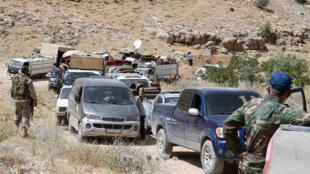 排隊等候進入黎巴嫩境內的敘利亞難民資料圖片