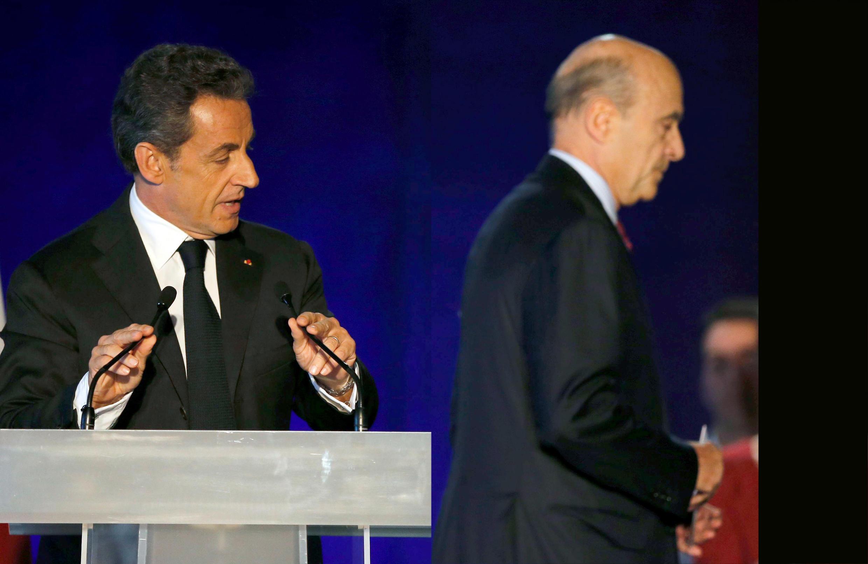 Nicolas Sarkozy et Alain Juppé lors du meeting à Bordeaux, le samedi 22 novembre 2014.