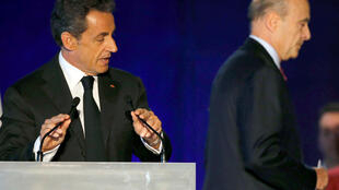 Nicolas Sarkozy e Alain Juppé durante um encontro em Bordeaux, no sábado dia 22 novembre 2014.