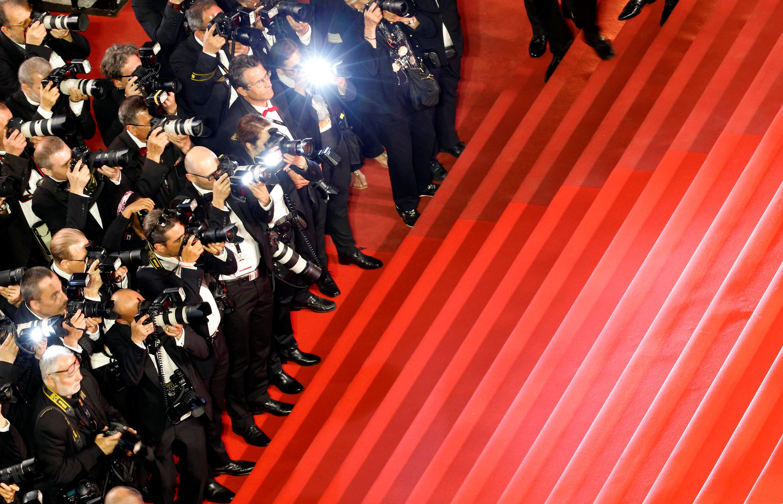 O tapete vermelho de Cannes e os fotógrafos.