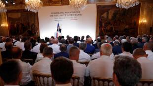 Macron presenting his plan to 500 top cops