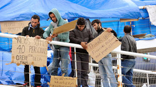 Syrian refugees demand the right to go to the UK in a protest in Calais this month