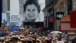 People gather near the Pantheon before a national tribute to late Auschwitz survivor and French health minister Simone Veil and her late husband Antoine Veil in Paris, France, July 1, 2018.