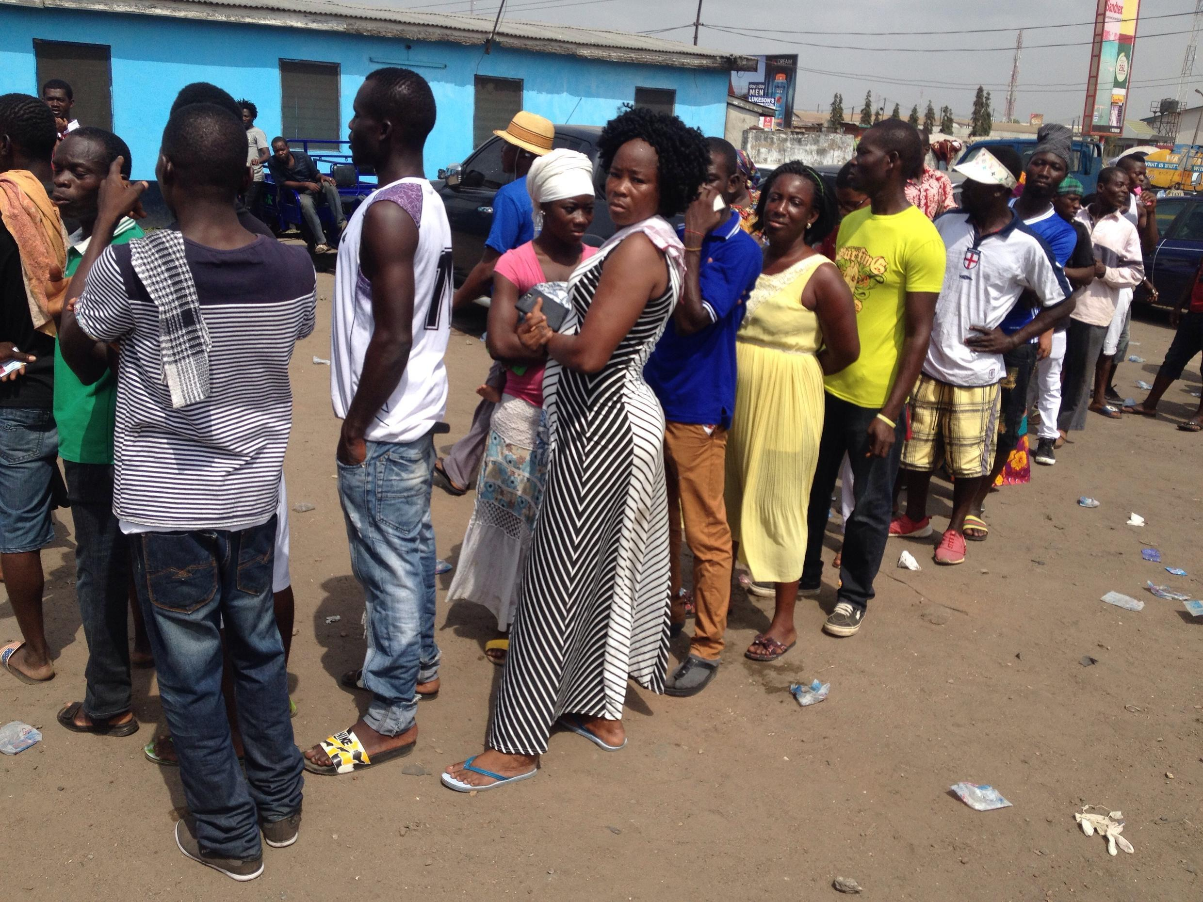 Voters wait in line at the Old Fadama Police Station polling station in Agbogbloshie, 7 December 2016.