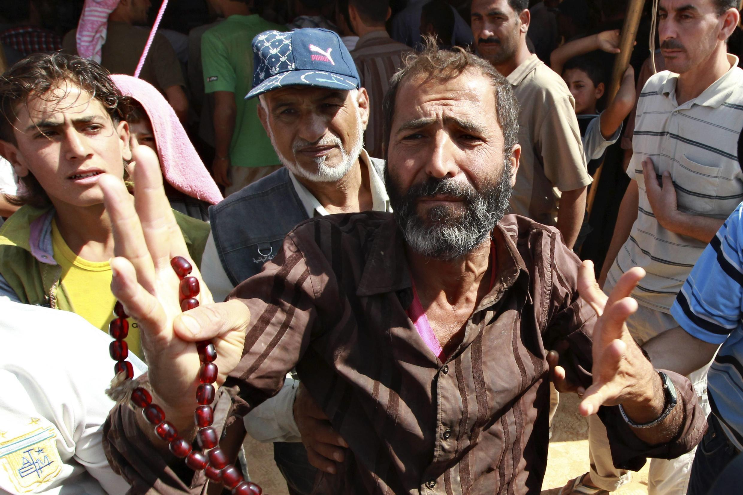 A Syrian refugee makes a complaint over the management of the Al Zaatri refugee camp in the Jordanian city of Mafraq