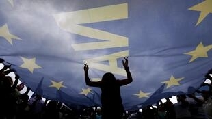 About 20 000 people demonstrated in favour of accepting negotiators' conditions in Athens on Tuesday