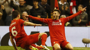 Liverpool's Adam Lallana celebrates with  with Dejan Lovren after scoring his side's third goal against Villareal on Thursday.
