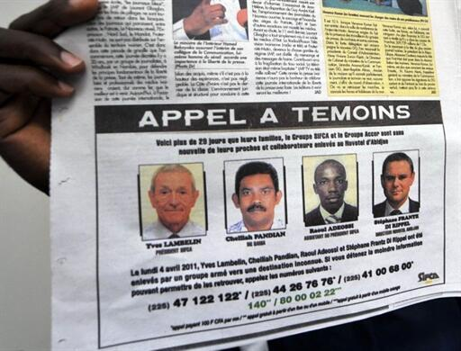 A poster appeals for witnesses of the killings