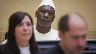 Thomas Lubanga with his lawyers, ICC courtroom,The Hague, 14 Mar 2012