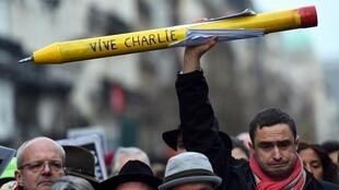 На акции в поддержку Charlie Hebdo, январь 2015 г.