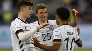 Kai Havertz (L) and Thomas Mueller (C) celebrate with Germany goalscorer Serge Gnabry in a Euro 2020 warm-up win over Latvia