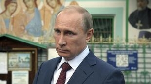 Le président russe Vladimir Poutine, le 10 septembre 2014 à Moscou, avant son départ pour le sommet de l'OCS ( organisation de coopération de Shanghai, les 11 et 12 septembre à Douchanbé, capitale du Tadjikistan.