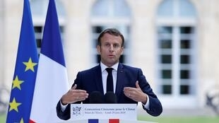 French President Emmanuel Macron addresses the members of the Citizens Climate Convention at the Elysée Palace on 29 June, 2020.