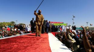 Le président soudanais Omar el-Béchir parmi ses partisans lors d'une manifestation à Khartoum, le 9 janvier 2019.