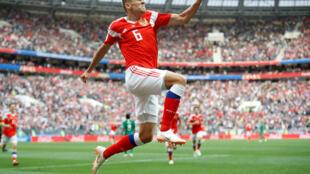 Denis Cheryshev after scoring against Saudi Arabia