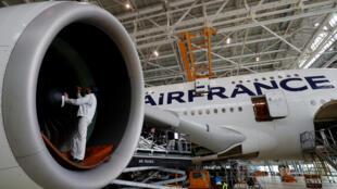 Work on an Airbus A380 plane inside the Air France KLM maintenance hangar at Paris Charles de Gaulle International Airport