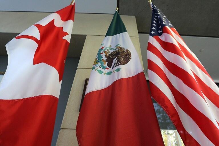 """هیئتهای اقتصادی آمریکا و کانادا شب گذشته در پایان شش هفته مذاکرات فشرده پیرامون انجام إصلاحات در پیمان تجاری """"نفتا"""" درباره موارد بازنگری در مفاد این پیمان به توافق رسیدند."""