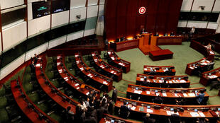 Security guards surround pro-independence legislator-elect Baggio Leung and some pro-democracy lawmakers after blocking Leung from retaking his oath inside the Legislative Council in Hong Kong, China November 2, 2016.