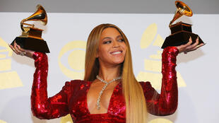 """Beyonce holds the awards she won for Best Urban Contemporary Album for """"Lemonade"""" and Best Music Video for """"Formation"""" at the 59th Annual Grammy Awards in Los Angeles, California, U.S. , February 12, 2017."""