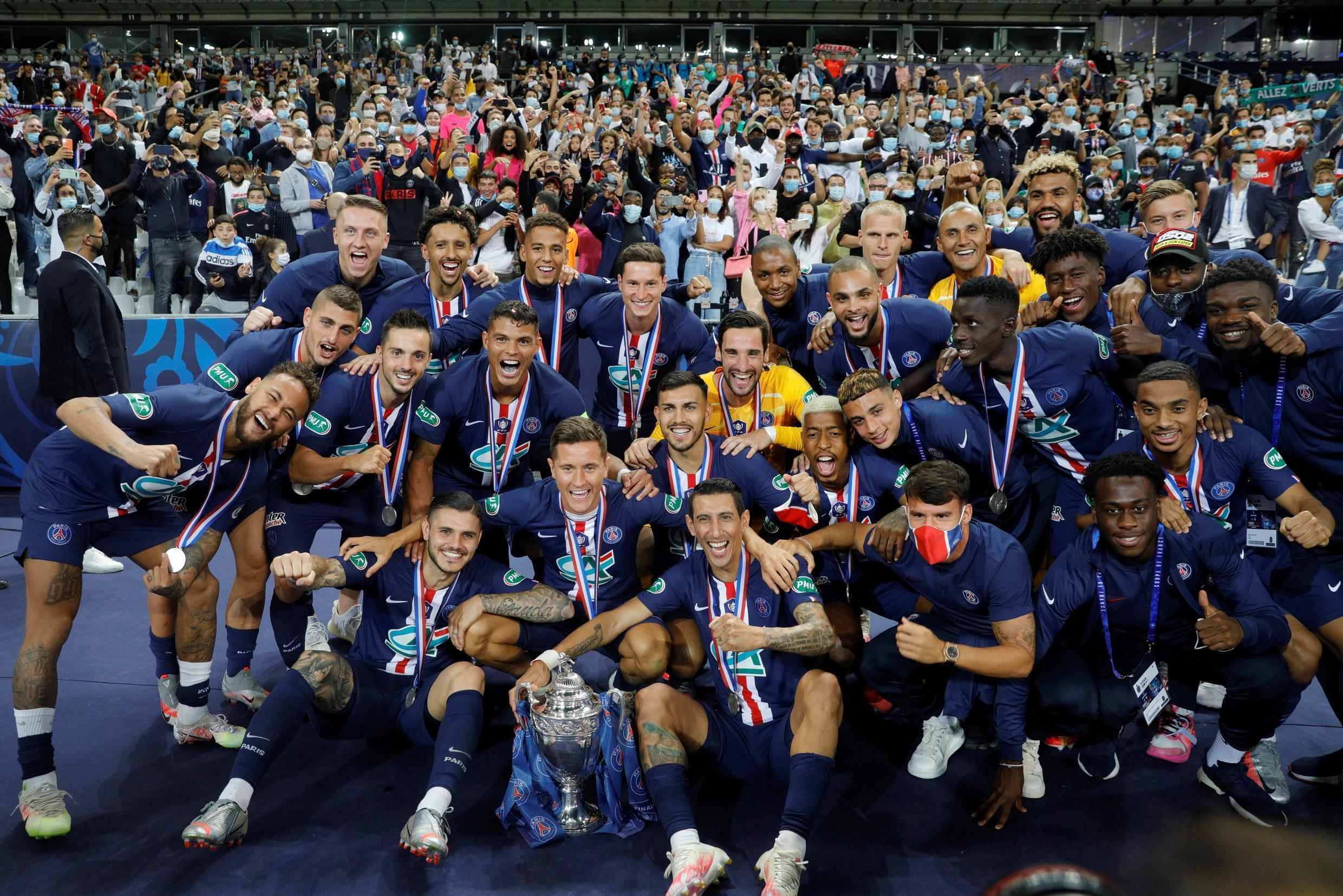 PSG players pose with the French Cup won against Saint-Etienne on 24 July 2020 at the Stade de France.