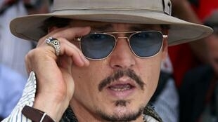 Johnny Depp working the red carpet at Cannes