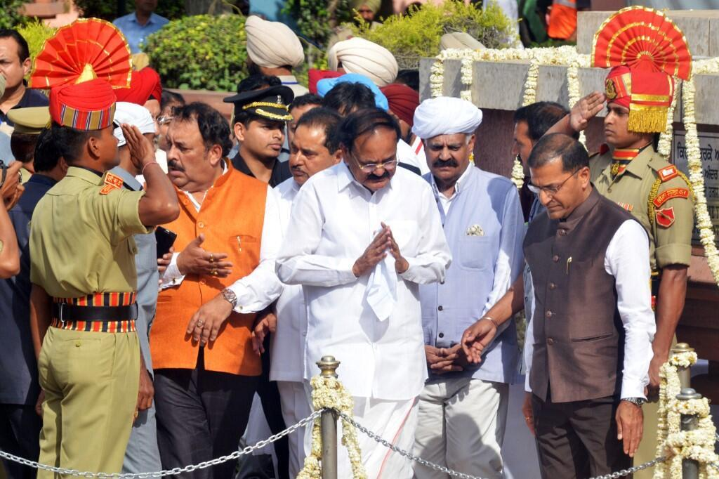 Indian Vice President Venkaiah Naidu pays tribute to the Amritsar massacre martyrs on the 100th anniversary at the Jallianwala Bagh memorial, on 13 April, 2019.