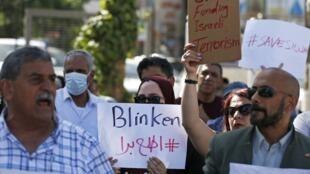 Une manifestation dans les rues de Ramallah lors de la visite d'Antony Blinken