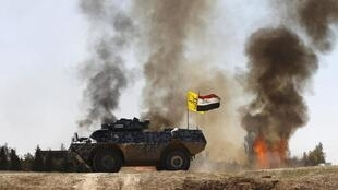Gari ya kivita ya jeshi la Iraq pamoja na wanamgambo wa Hashid sha'bi katika vita dhidi ya IS katika kijiji cha Al-Alam, Machi 10 mwaka 2015.