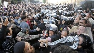 Demonstrators tussle with police in Cairo Tuesday
