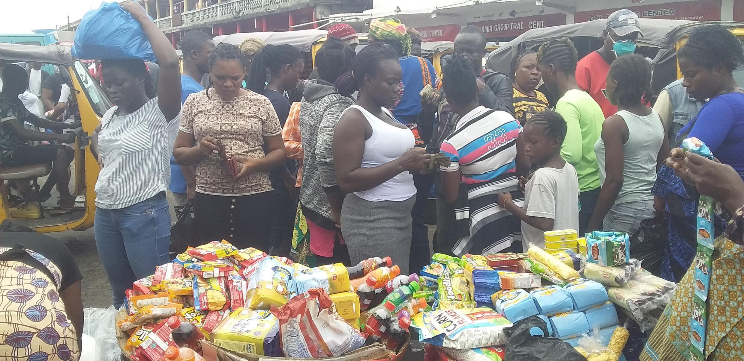 People rushing to buy food in Monrovia, Liberia before the Covid-19 lockdown on Saturday