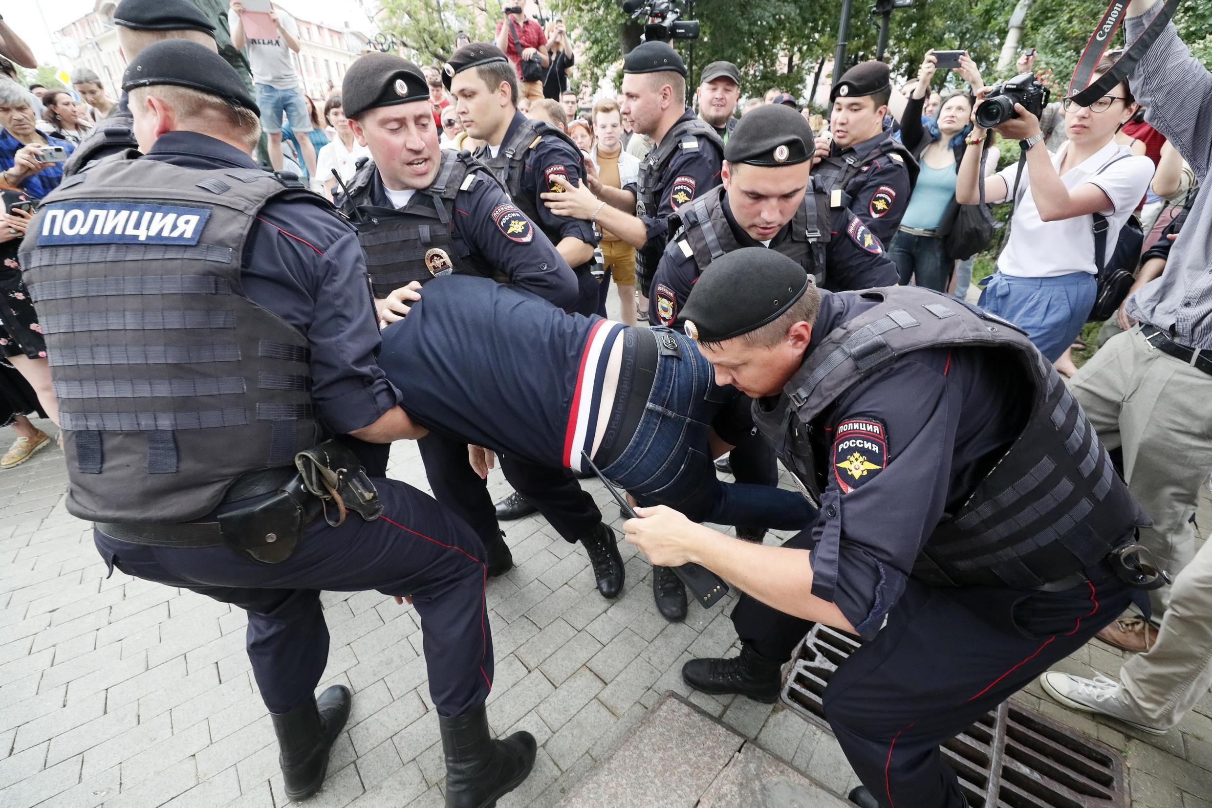 Law enforcement officers detain a participant of a rally in support of Russian investigative journalist Ivan Golunov, who was detained by police, accused of drug offences and later freed from house arrest, in Moscow, Russia June 12, 2019.