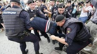 Police detain a participant of a rally in support of Russian investigative journalist Ivan Golunov, Moscow, Russia 12 June 2019.